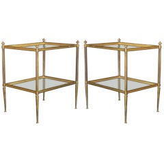 A pair of French bronze two tiered end tables