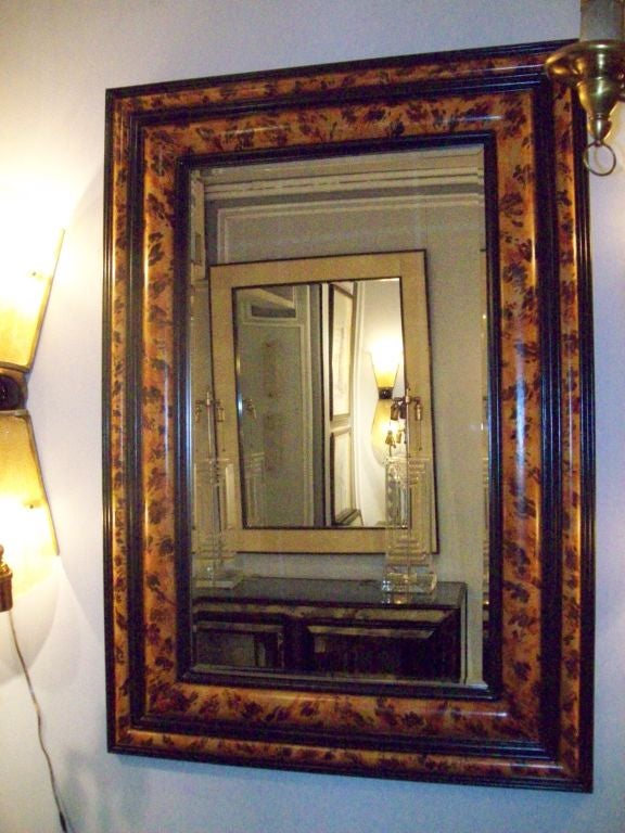 A pair of faux-painted bevelled mirrors.