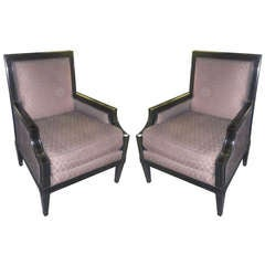 A Pair of Ebonized Armchairs on Tapered Legs