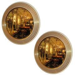 An Exquisite Pair of Circular Giltwood Mirrors