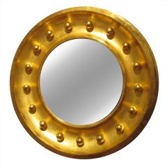 An Exquisite Giltwood Bull's Eye Mirror