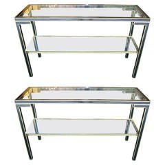 Pair of Ebonized and Parcel-Gilt Two-Tiered Console Tables