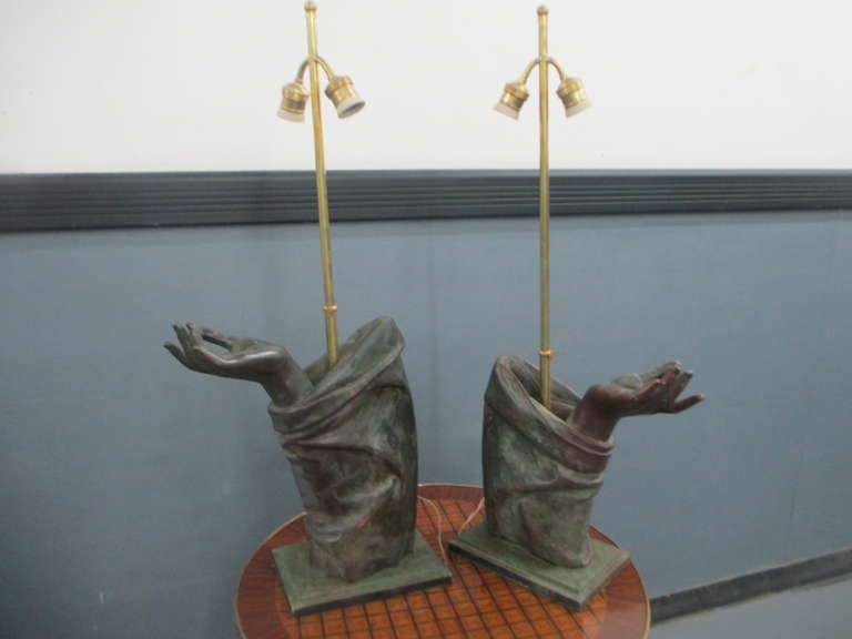 A sculptural pair of bronze hand, later converted into lamps, great detail and quality, the overall height of the lamps is 32