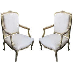 Pair of Painted Giltwood Bergeres/ Armchairs in the Regence Manner