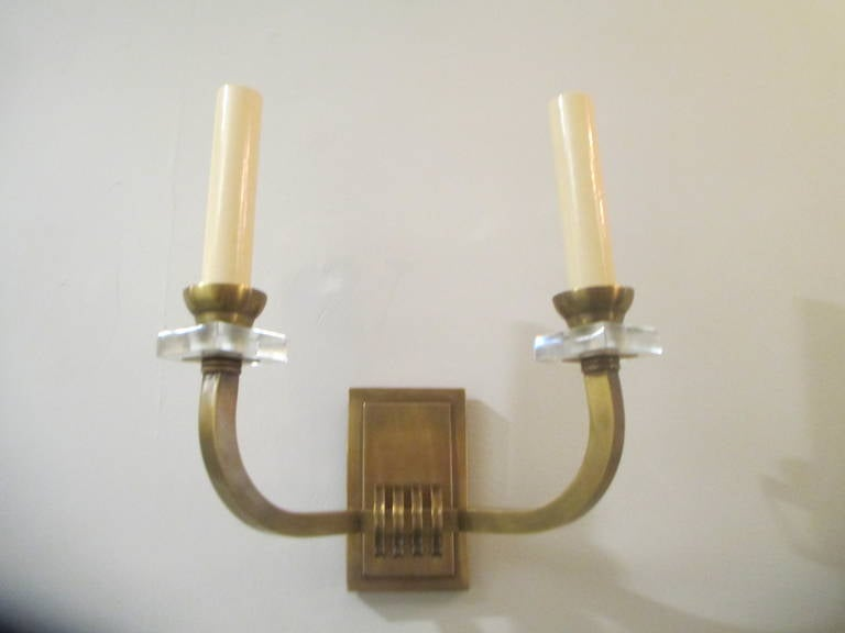 Custom pair of bronze two-arm sconces.