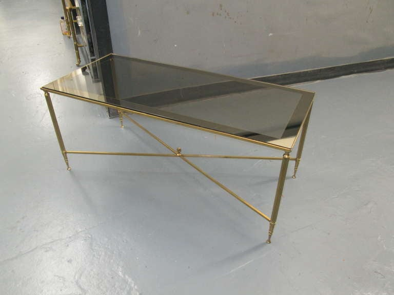 Rectangular brass coffee table with smoked glass.