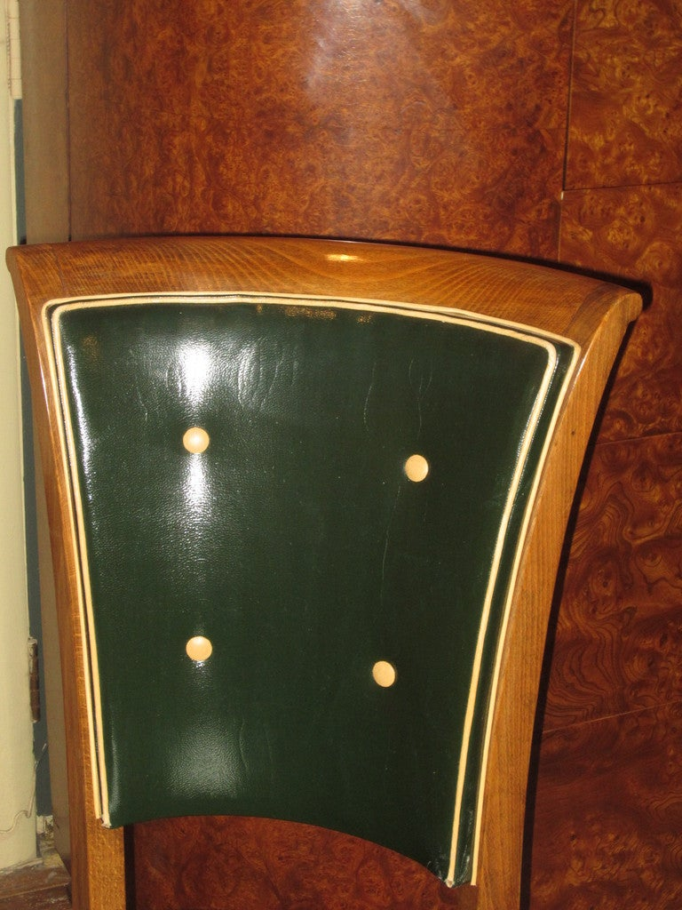A set of eight French Art Deco dining chairs.