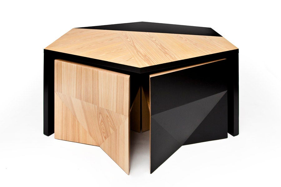Hexagonal table with nesting chairs by rafael de cardenas