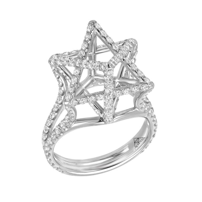 This heirloom-quality large platinum Merkaba ring features a total of approximately 2.02 carats of round brilliant diamonds, F-G color and VVS2-VS1 clarity. This three dimensional architectural design extends upward from the hand, 0.53 inches. Each