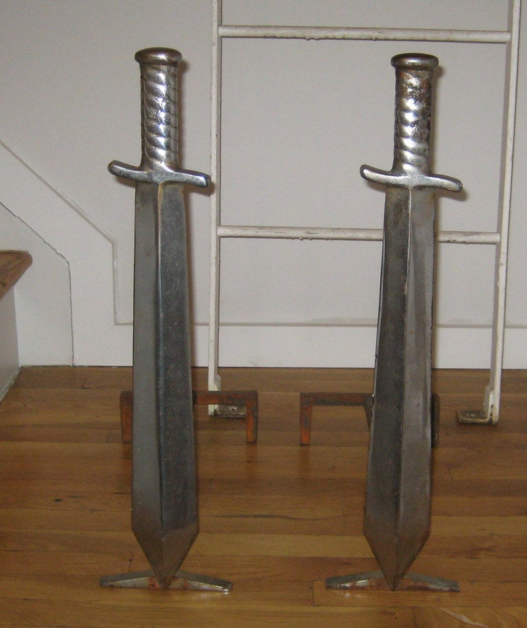 Whimsical chromed iron sword-form andirons.