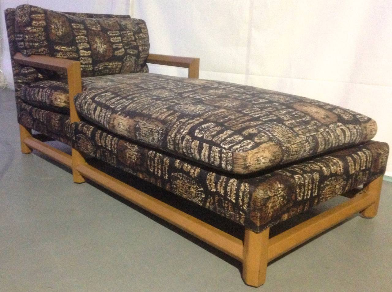 Chic leather-wrapped chaise longue with original batik fabric. Over-stuffed cotton cushions on camel leather-wrapped octagonal stretcher base. Acquired from the same estate that our other, verified, Springer pieces came from.