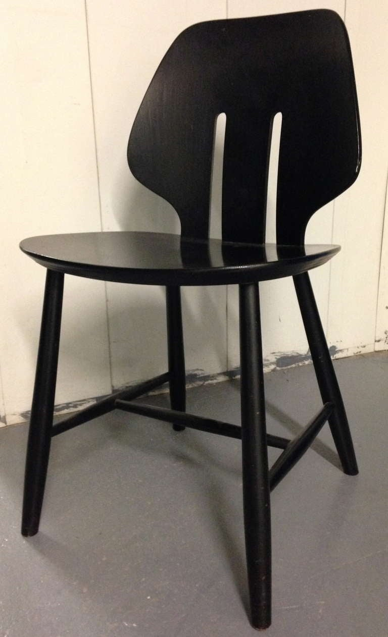 Four ebonized wood side chairs with bentwood cutout back. Stamped to underside.