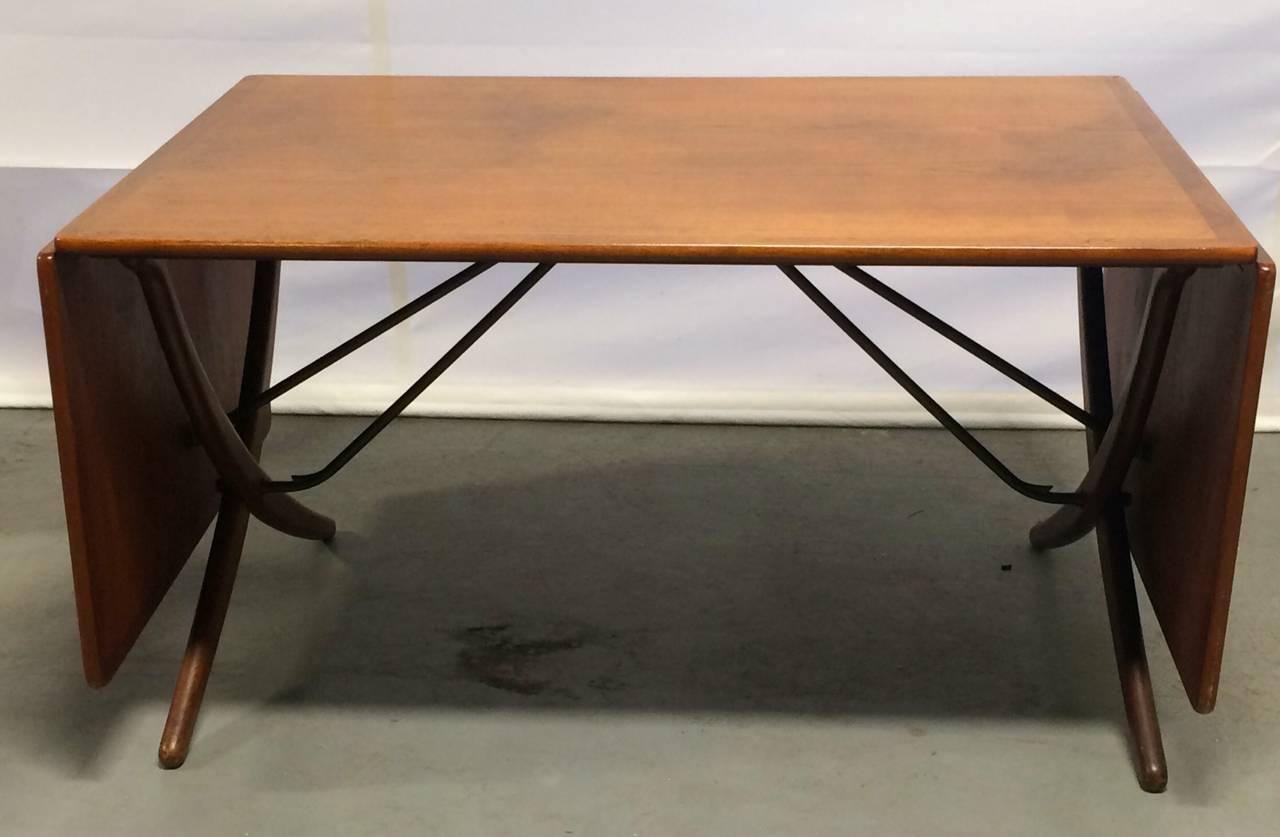 One of the best Wegner table designs. Teak top and curved legs are beautifully offset by the solid brass leaf mechanism. A wonderful marriage of form and function. Branded to the underside. 95