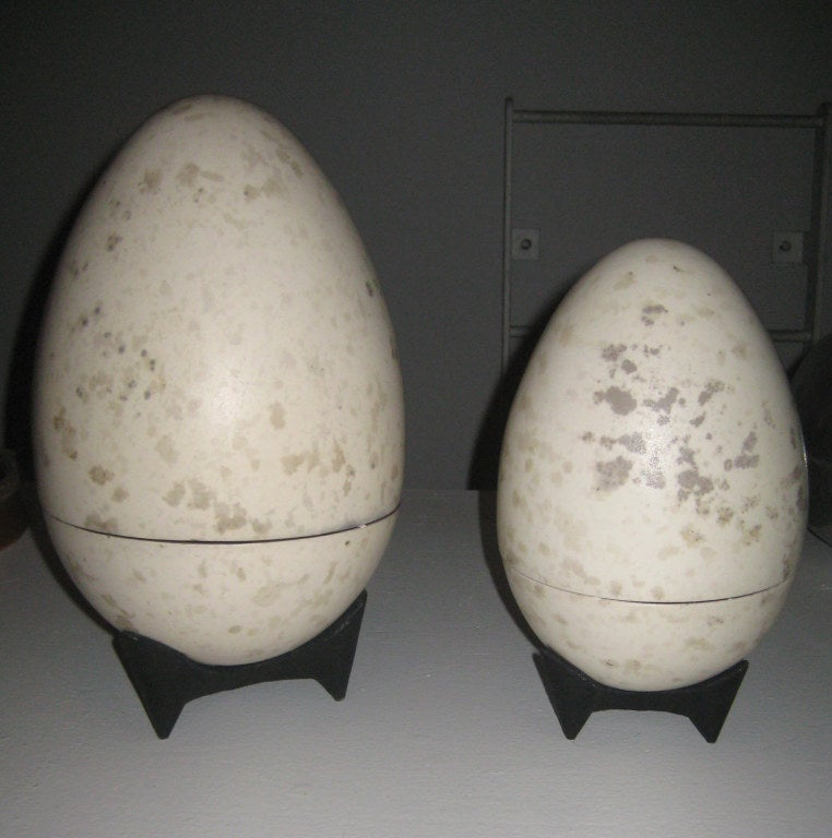 "13"" and 10"" ceramic egg sculptures with glazed surfaces that mimic actual eggs. Very pop meets organic modernism. The larger one is about the biggest egg box Hedberg made. Hans Hedberg was Swedish, but studied ceramics in Venice; he was the first"