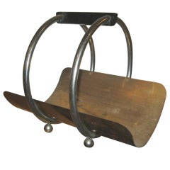 Log Holder by Norman Bel Geddes