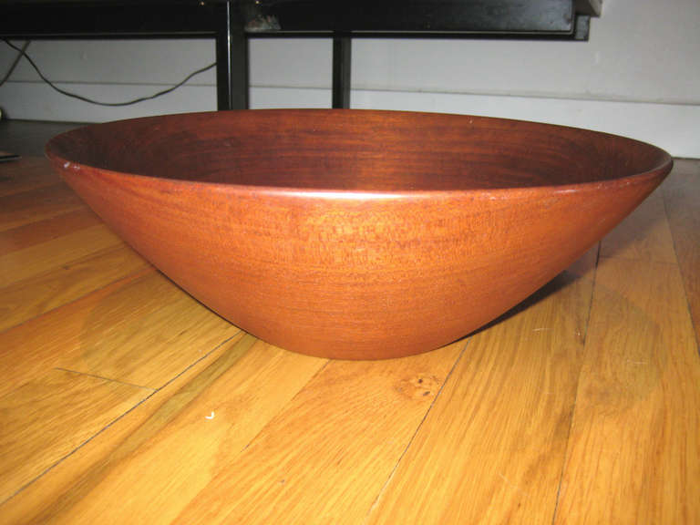 Large teak lathe turned bowl by studio Craft legend Paul Eshelman. Eshelman was part of the first generation studio woodworkers who sought to find artistic expression in simple, utilitarian objects. He was considered a master of form and graceful