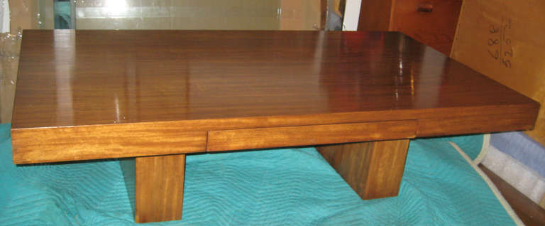 Simple early modern design by Edward Wormley for Dunbar distinguishes itself my its great proportions, chunky geometric shape, and wonderful dappled mahogany veneer. Original finish has fantastic warm tone. One drawer with Dunbar brand to underside.