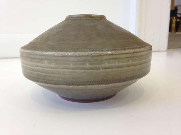 Fantastic modernist saucer shape vase in matte grey glaze. Hand-thrown one of a kind vase by master potter Carl Harry Stalhane, head designer for Rorstrand pottery. Signed and dated on underside.