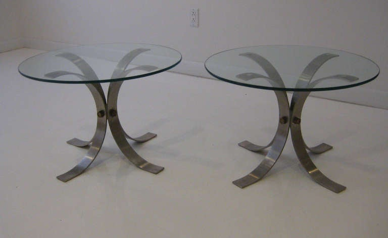 Chic side tables of curved aluminum petals joined with large bronze hardware and plate glass top.