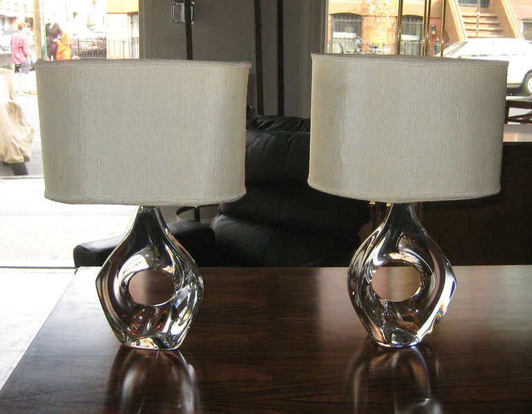 Beautiful amorphic, freehand-formed lead crystal lamps by Michel Daum, with original shades. Both lamps signed