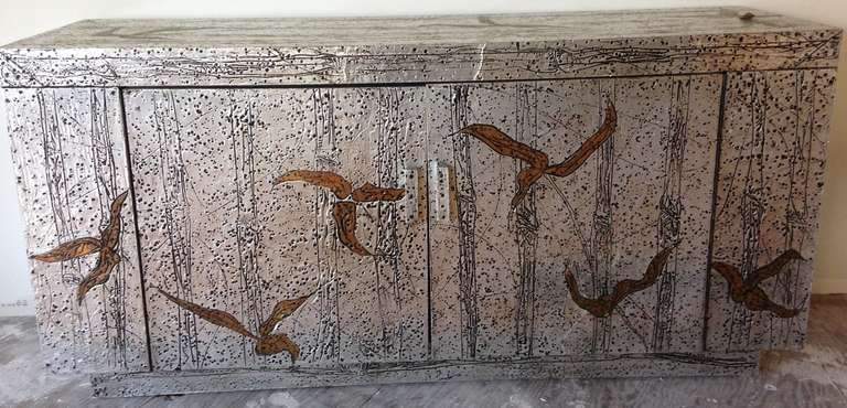 Handmade hand-hammered aluminum and copper sheathed sideboard. Signed.