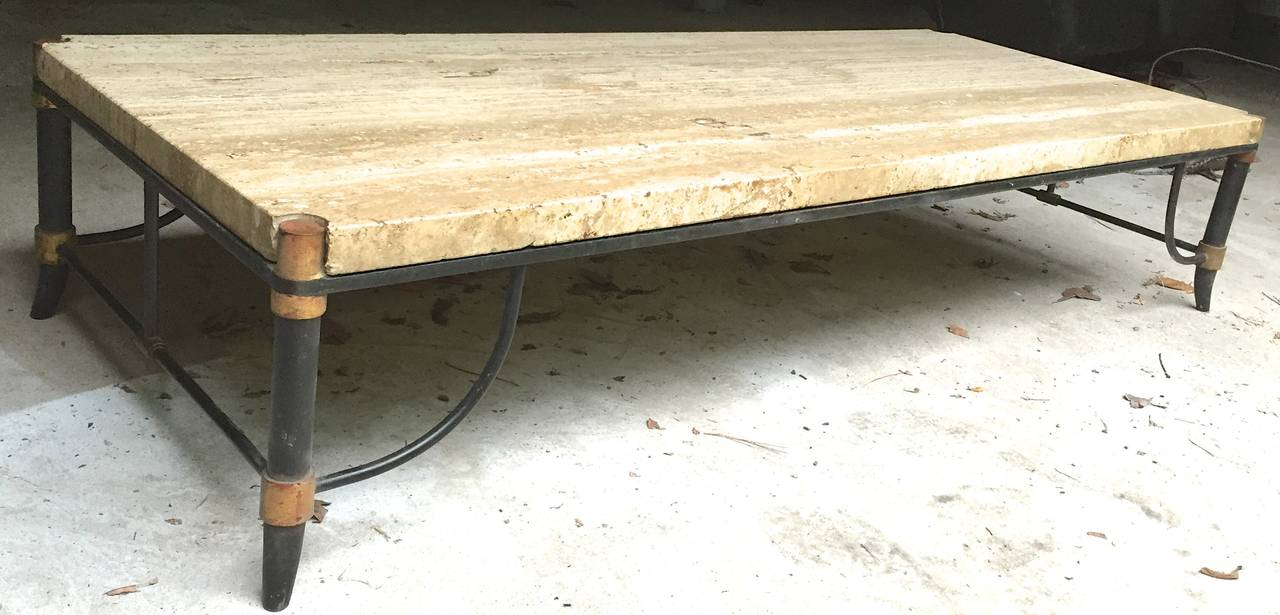 Chic 1940s table with saber legs and curved stretchers, bronze doré´ decoration, and an inset 11/2