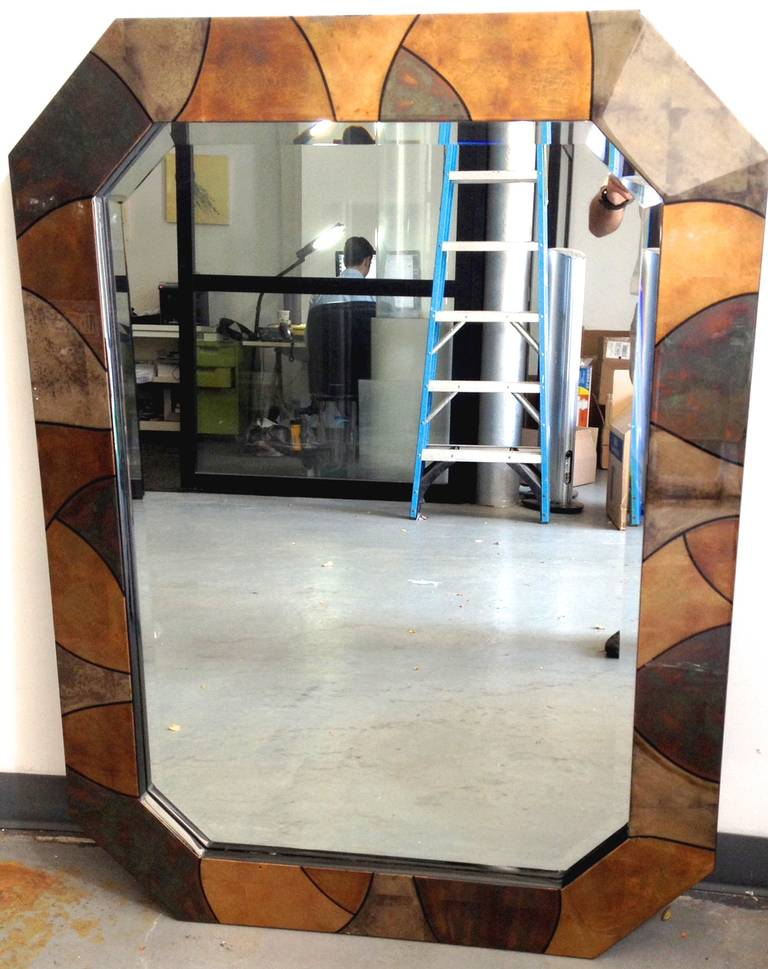 "Incredible custom-designed mirror with multicolored dyed goatskin panels arranged into a colorful patchwork over an octagonal frame. Signed ""Karl Springer LTD"" under the lacquer finish on one parchment panel."