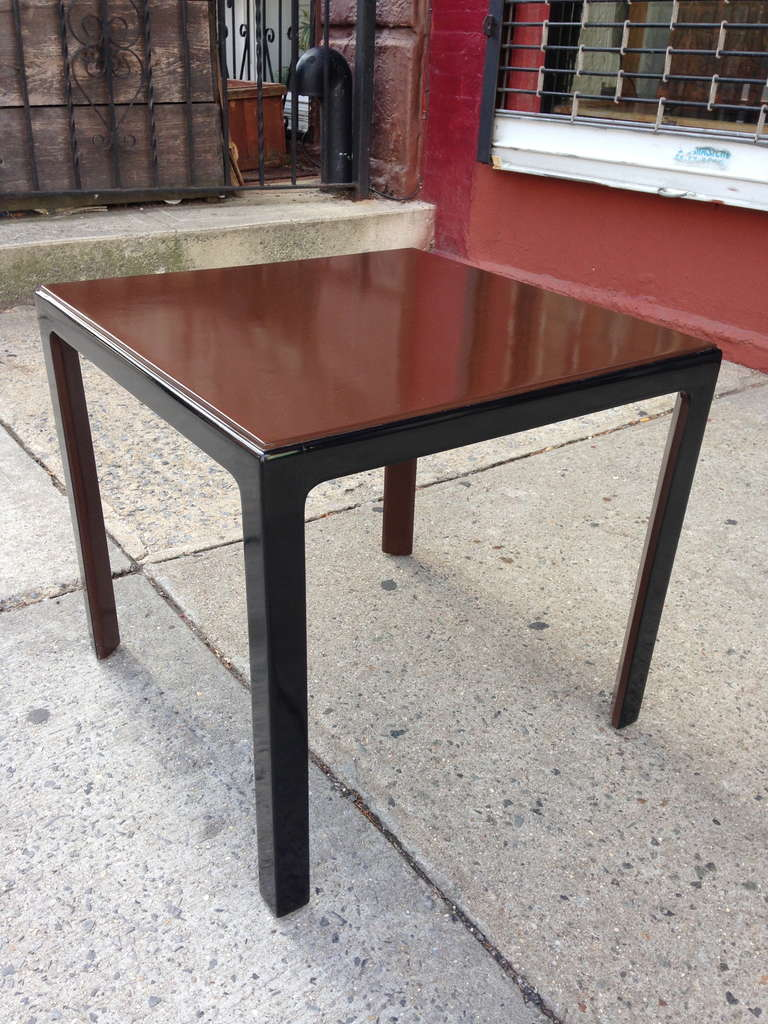 Designed in the mid-1940s for the estate of Jean Howard and Charles K. Feldman, this sweet little table has beautiful proportions and detailing with angled legs and raised top. Black painted lacquer frame, with brown lacquered surface and interior