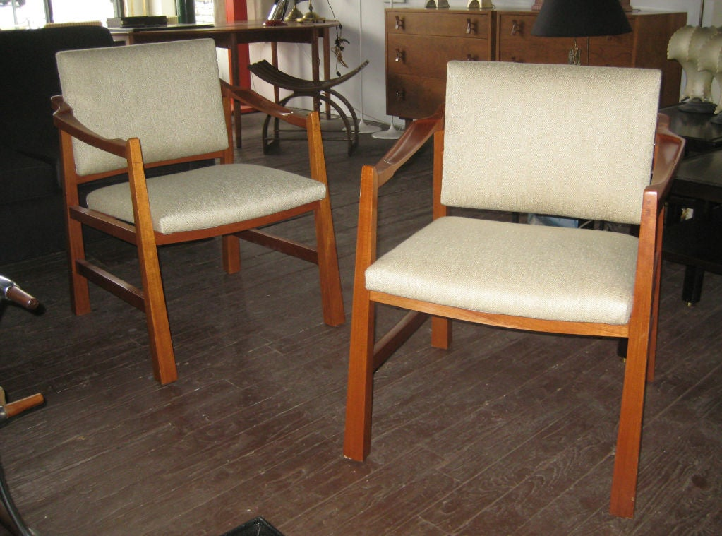 Generously proportioned occasional chairs, handmade in Mexico employing traditional woodworking techniques. Wonderful details including reverse tapered legs and intricately carved armrests imbue the chairs with a strong Mexican rustic modernism.
