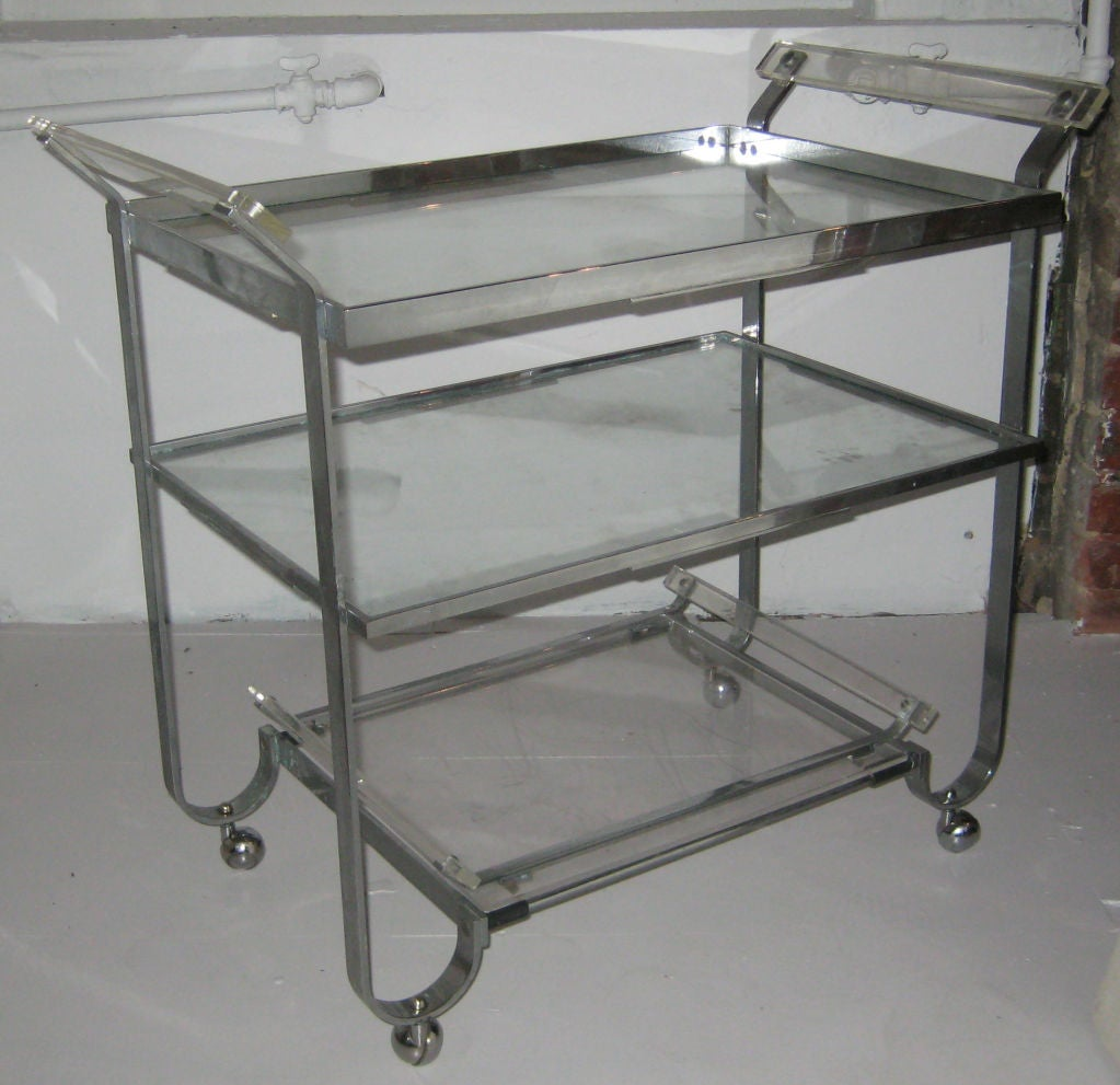 Super high-quality nickeled flatbar brass bar cart, on chrome casters, with Lucite handles. Bottom shelf functions as a serving tray. Made by legendary metal shop, Treitel Gratz, known for handling metal fabrication for such design icons as Donald