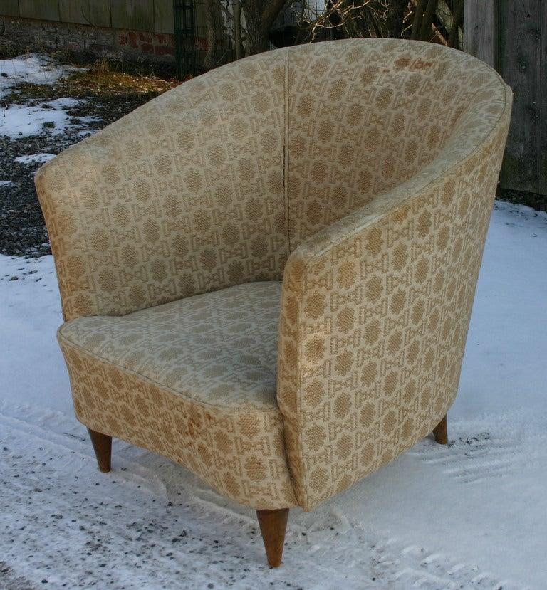 Single Italian barrelback armchair in vintage original upholstery.