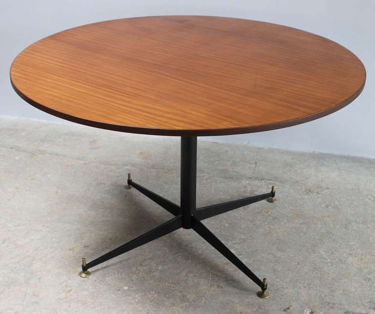 And Italian metal pedestal table with brass sabots and wood top, in the manner of Osvaldo Borsani for Tecno.