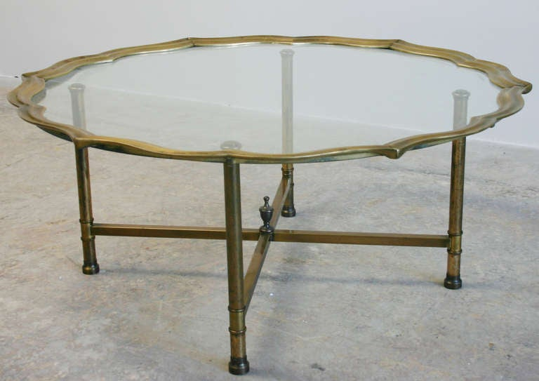 Regency style patinaed brass and glass coffee or cocktail table with pie crust edge detail; removable tray top.