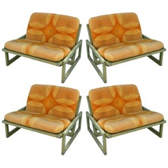 Four Cassina Lounge Chairs