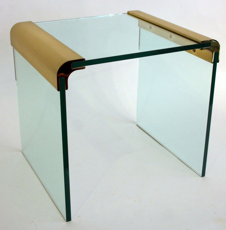 Pair Pace side table with 1/2 inch thick glass and brass joins.