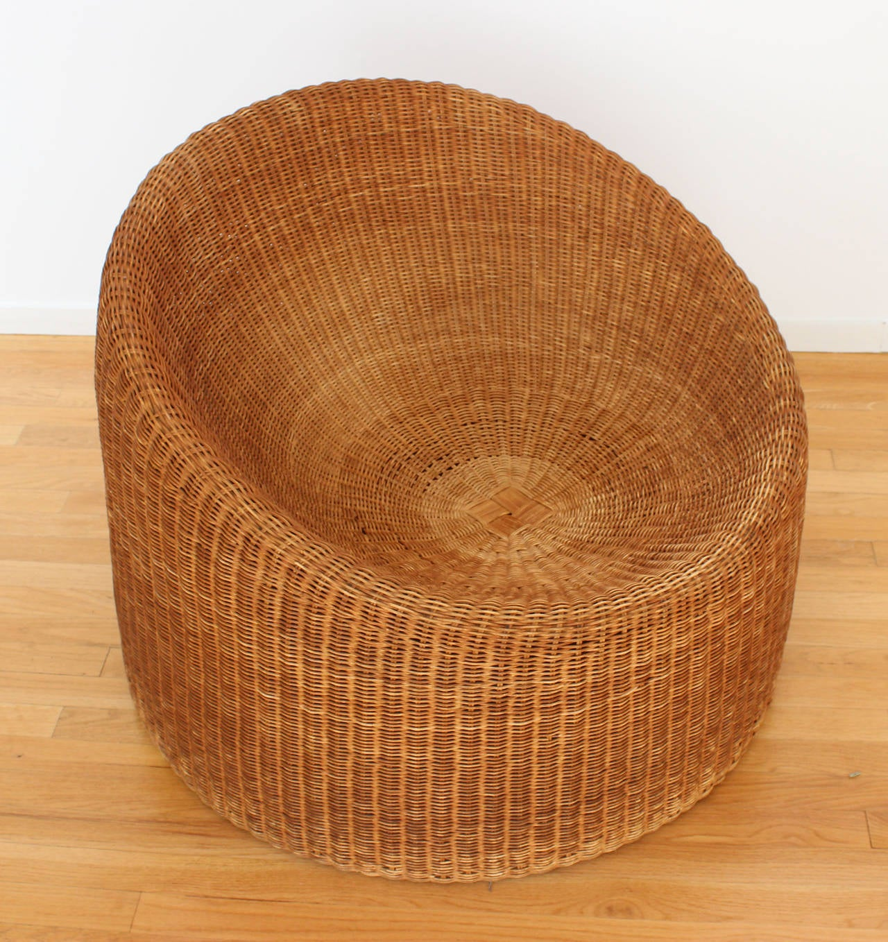 A woven rattan chair designed by Eero Aarnio (b. Helsinki, 1932) for Stendig.