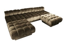 A Three-Section Deep Tufted Sofa and Ottomans by Harvey Probber