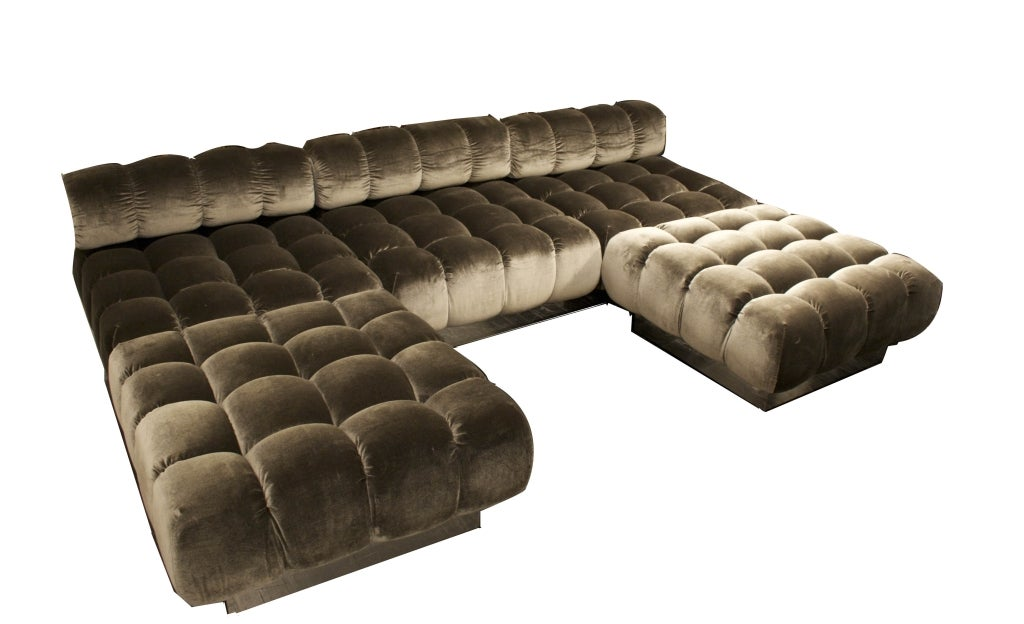 A Three Section Deep Tufted Sofa And Ottomans By Harvey