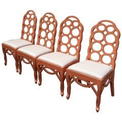 A Set of Four Lacquered Loop Back Chairs by Frances Elkins