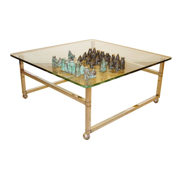 A modern chrome and glass games table with bronze chess for Contemporary game table and chairs
