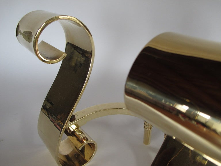 A Pair of Polished Scroll Brass Andirons In Excellent Condition For Sale In St.Petersburg, FL