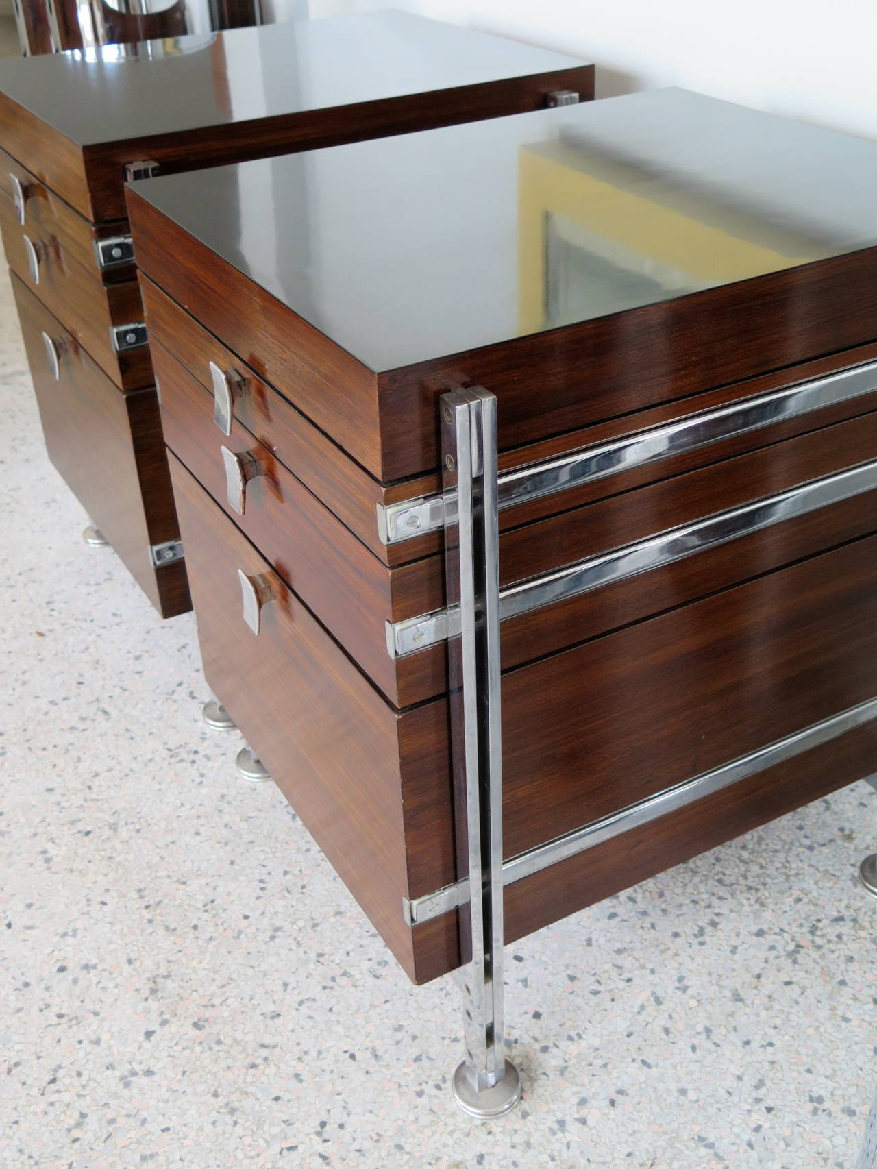 A pair of rosewood and chrome-plated steel cabinets by Jules Wabbes, Belgium, circa 1960s.