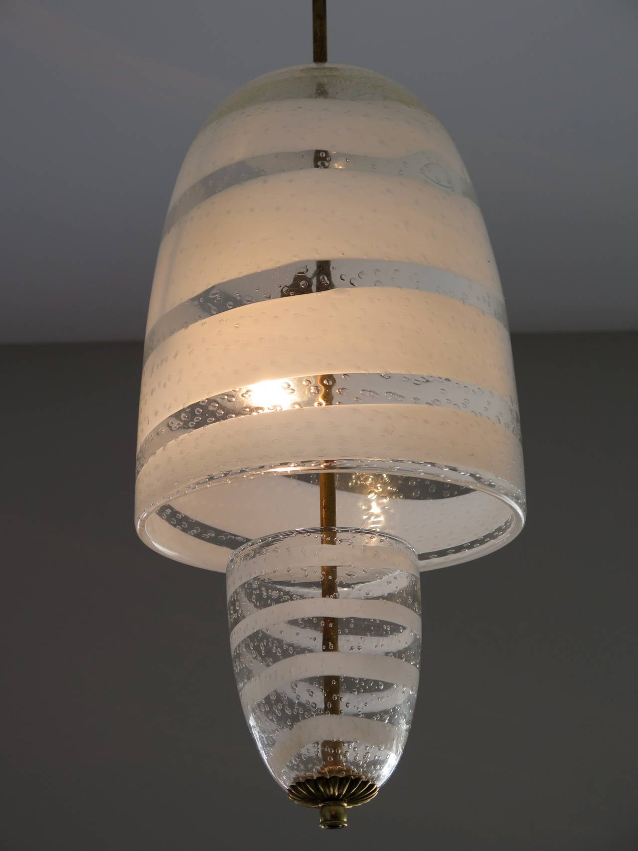 An unusual Italian chandelier by Seguso, circa 1950s. Cased white and clear glass with bubbles.