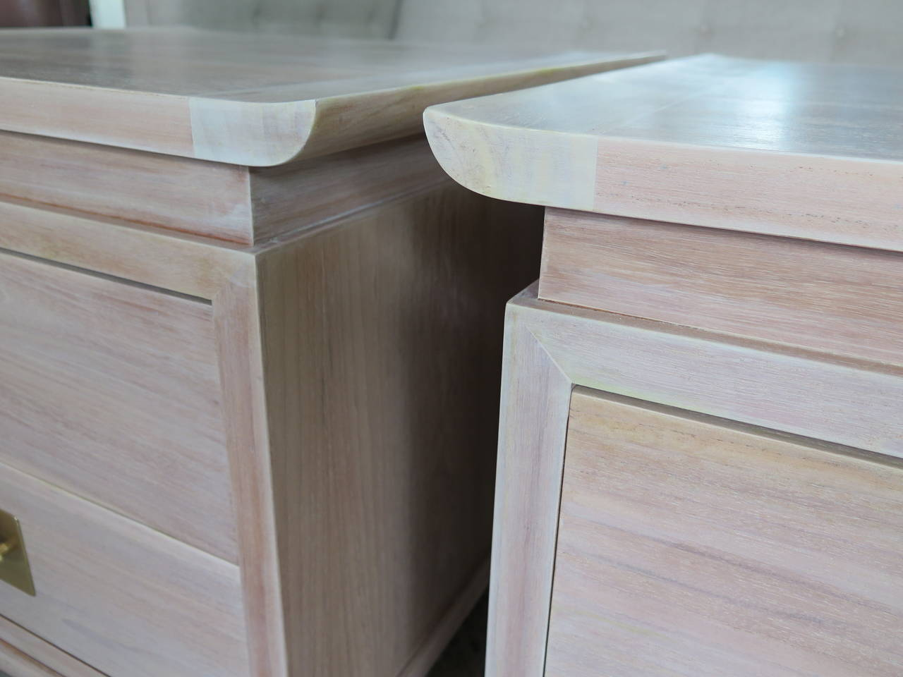 A great pair of Chinese style nightstands. Elegant raised edges, heavy, solid brass newly polished hardware (brushed satin lacquered finish). The cabinet backs are finished. New white wash/pickled finish.