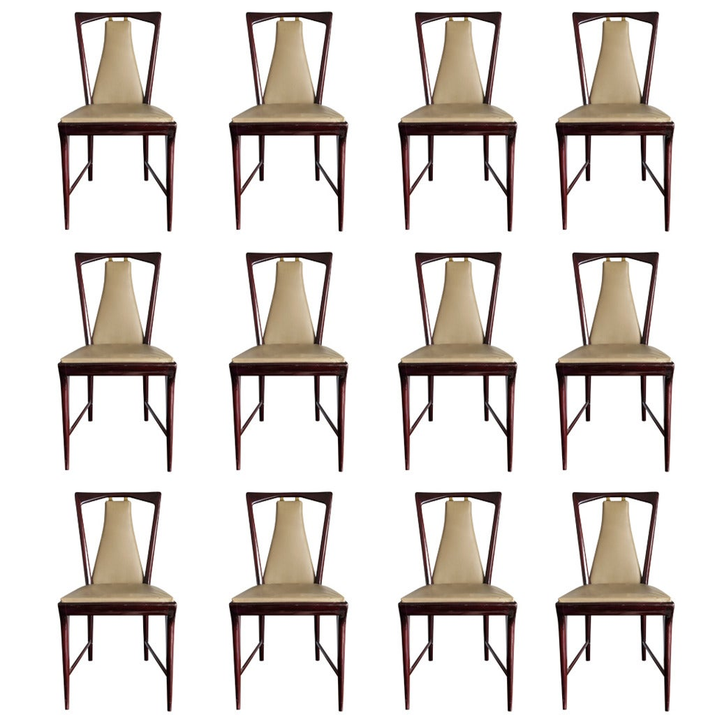 Set of 12 Elegant Chairs in the style of Osvaldo Borsani For Sale