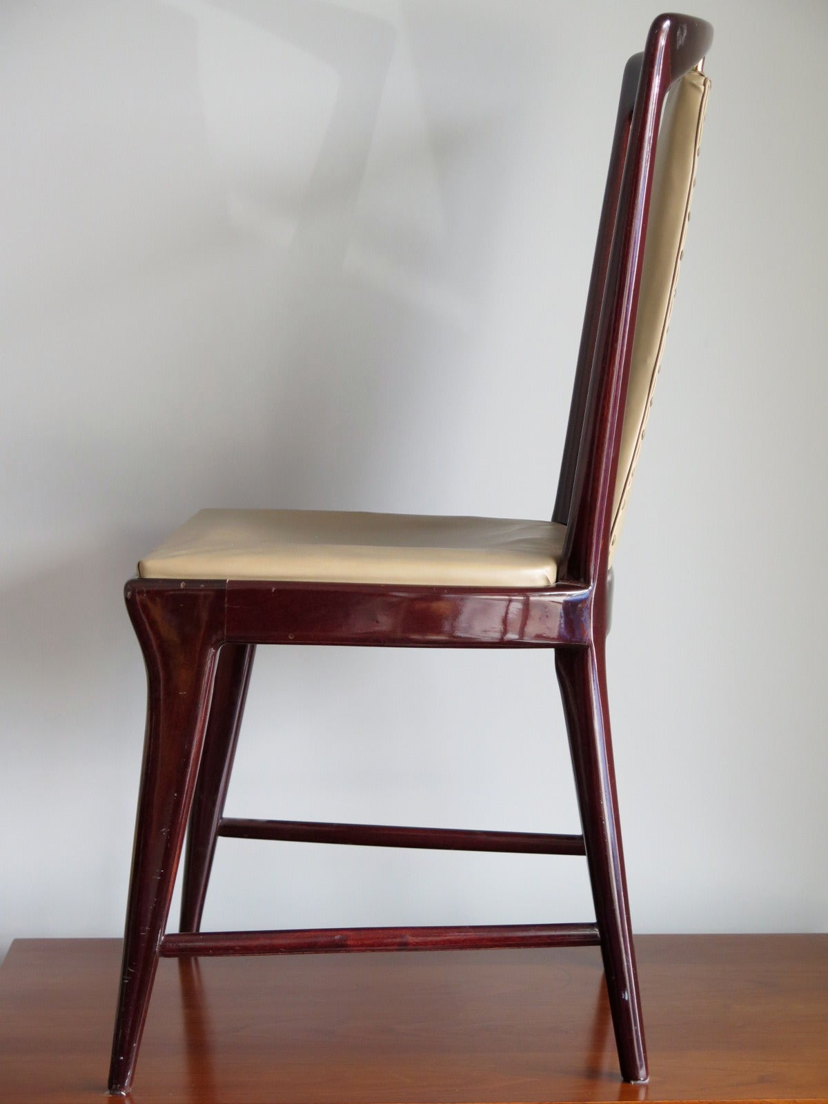 Set of 12 Elegant Chairs in the style of Osvaldo Borsani In Good Condition For Sale In St.Petersburg, FL