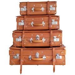 Set of Four Vintage Unused Leather Suitcases