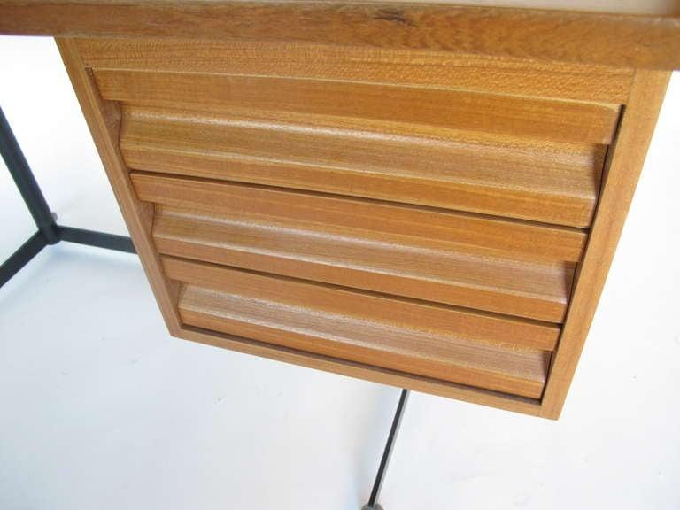 A classic and rare, circa 1950s Osvaldo Borsani for Tecno desk with teak top.