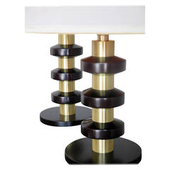 A Pair of Stacked Walnut and Brass Lamps