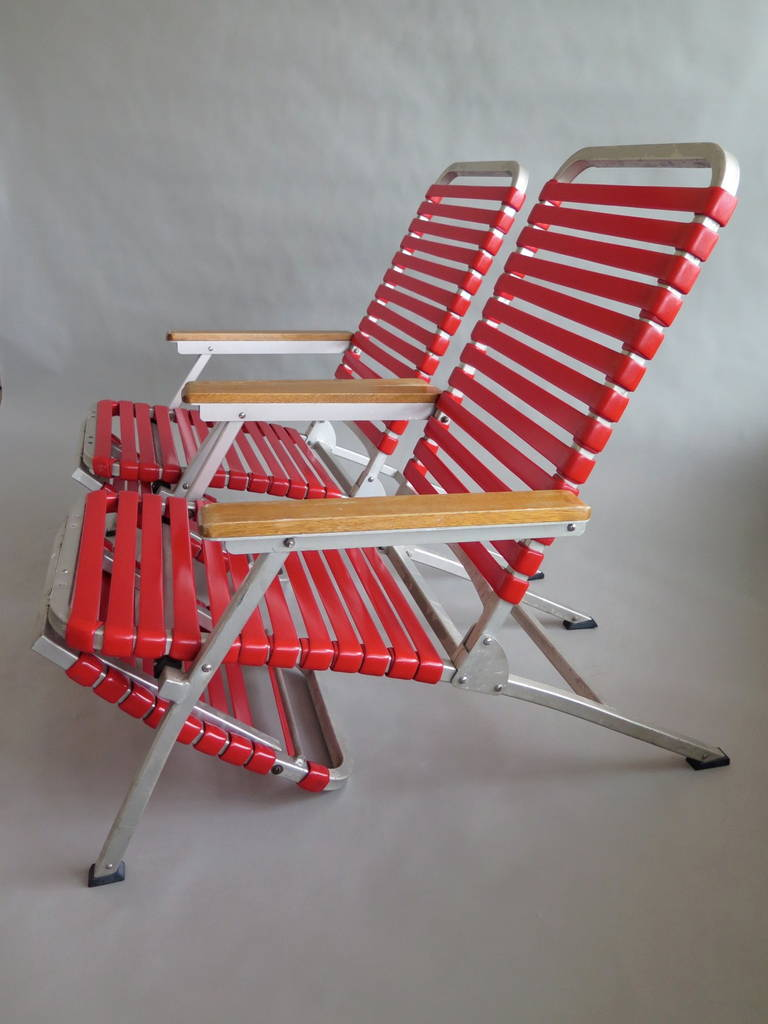 A pair of aluminum folding chaise lounges from ss united for Aluminum folding chaise lounge